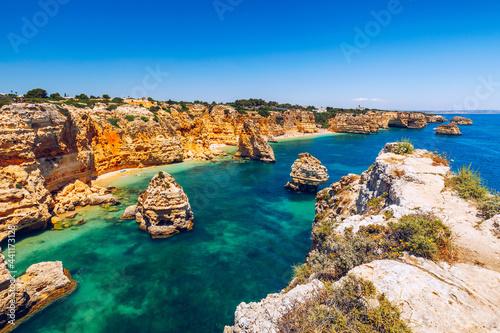 Praia da Marinha, beautiful beach Marinha in Algarve, Portugal. Navy Beach (Praia da Marinha), one of the most famous beaches of Portugal, located on the Atlantic coast in Lagoa Municipality, Algarve.