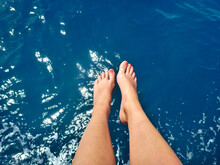 Low Section Of Woman Feet Above The Ocean