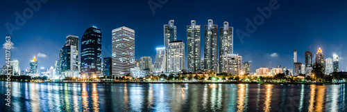 Fotografie, Tablou Panorama Beautiful skyscrapers at night in a modern and civilized city