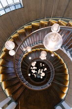 Majestic Spiral Staircase With Hanging Pendant Lamps