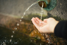 Close-up Of Hand Collecting Water In Hands