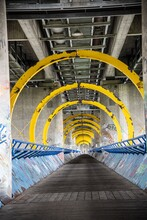 Futuristic Footpath Under A Road Bridge Across The Danube River In Vienna Diminishing View