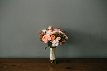 Flower Bouquet On Table Against Wall