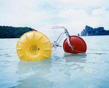 Yellow Vessle Floating On Water Against Sky