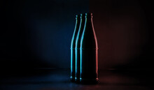 Close-up Of Glass Bottles On Table Against Black Background
