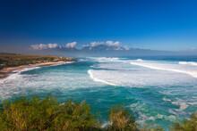 Scenic View Of Hookipa Beach Park On The Hawaiian Island Of Maui, Usa Against Blue Sky