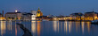 A beautiful night cityscape of downtown Helsinki. Illuminated buildings casting reflections on the calm water.