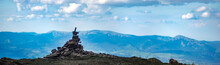 A Pile Of Stones On A Mountain Top In The Carpathian Mountains In Summer