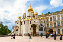View Of The Annunciation Cathedral On The Cathedral Square Of The Moscow Kremlin On A Sunny Summer Day Against The Background Of The Grand Kremlin Palace. Moscow, Russia