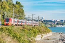 Passenger Train Moves Along Black Sea Coast. Sochi.