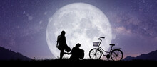 Silhouette At Night Landscape Of Couple Or Lover Dancing And Singing On The Mountain With Milky Way Background Over The Full Moon.