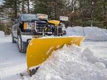 Pickup Truck Plowing Snow Off Driveway