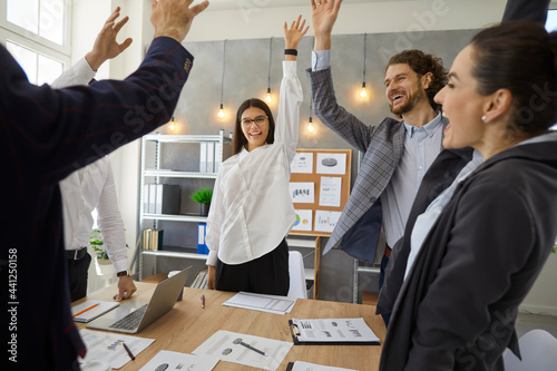 Canvas Print Happy business team celebrating successful completion of project