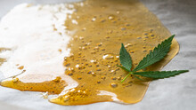 Strong Extract Of Gold Cannabis Wax With High Thc Close Up