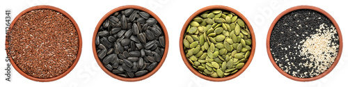 Set of pumpkin seeds, flax seeds, sesame seeds and sunflower seeds in bowls isolated on white background. Top view, panorama.