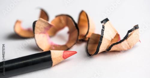 Fotografie, Obraz Sharp red lip pencils lying next to shavings