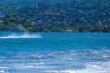 Water Motorcycle In Blue Sea On Clear Sunny Day. Water Bike On Waves Of Sea, Homem Com Jet Sky Na água