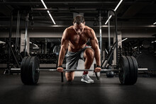 Athlete, Man Doing Deadlift With A Barbell Young Athlete Preparing For A Heavy Weight Barbell Lifting Workout