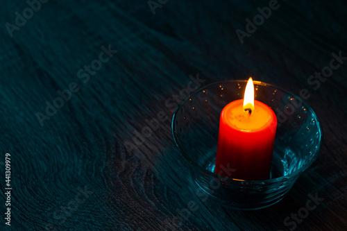 Fotografie, Obraz One red paraffin candle in glass decorative candlesticks