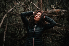 Young Woman Looking Away In Forest