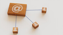 Email Technology Concept With @ Symbol On A Wooden Block. User Network Connections Are Represented With Blue String. White Background. 3D Render.