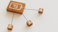 Environmental Energy Technology Concept With Eco Battery Symbol On A Wooden Block. User Network Connections Are Represented With Blue String. White Background. 3D Render.