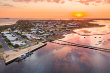 Aerial View Of A Sunset Of A Coastal Yacht Club And Marina