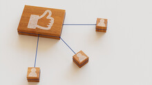 Social Media Technology Concept With Like Symbol On A Wooden Block. User Network Connections Are Represented With Blue String. White Background. 3D Render.