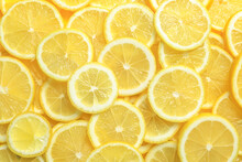 Many Fresh Juicy Lemon Slices As Background, Top View