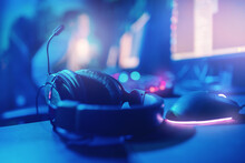 Professional Headphones With Microphone For Video Games And Cyber Sports On Background Blue Dark Light