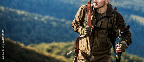 Obraz na plátně Hunter with hunting gun and hunting form to hunt