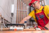 Fototapeta Łazienka - Residential Heating Systems Technician at Work