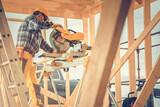 Fototapeta Łazienka - Construction Contractor Worker Using Powerful Wood Saw