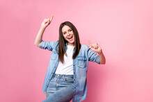 Photo Of Pretty Charming Young Woman Dressed Jeans Shirt Dancing Pointing Fingers Empty Space Isolated Pink Color Background