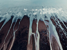 Aerial Sea Landscape With Foamy Waves And Stony Shore