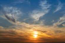 Calm On The Coast. The Sky In The Evening. Water. Sunset Sky On The Coast. Golden Hour. Sky And Clouds. Feather Cloud. The Sun Went Down Below The Horizon. Evening Sky Background. Sunrise Landscape