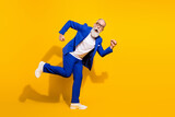 Full length body size view of attractive childish man running fooling having fun isolated over bright yellow color background