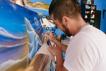Artist Removing Paper From Artwork