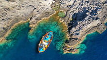 Aerial Drone Top View Photo Of Colourful Wooden Traditional Fishing Boat In Emerald Sea Shore Of Zakynthos Island, Ionian, Greece