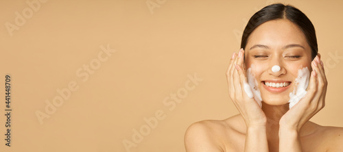 Fotografiet Website header of Studio portrait of pleased young woman smiling with eyes close