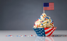 Cupcake. American Flag. US Holidays. Cake On 4th Of July, Independence, Presidents Day. Tasty Cupcakes With White Cream Icing And Colored Stars Sprinkles. USA Patriotism. Sweet Dessert. Copy Space.