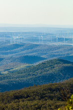 Coopers Gap Wind Farm In Southern Queensland Viewed From The Distant Bunya Mountains