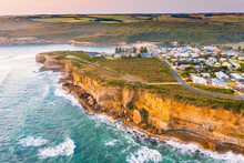 Aerial View Of A Coastal Town On Sea Cliffs Above A Rugged Coastline