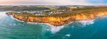 Aerial Panorama Of A Coastal Town On Sea Cliffs Above A Rugged Coastline