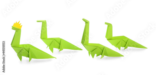 Fototapeta Origami dinosaurs on white background. Concept of uniqueness