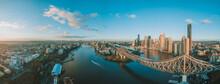 Panorama Sunrise Aerial Shot Of Brisbane, The Story Bridge And The Brisbane River