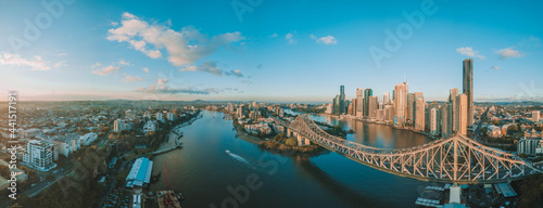 Fotografie, Obraz Panorama sunrise aerial shot of Brisbane, the Story Bridge and the Brisbane Rive