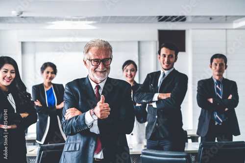 Fotografie, Obraz Senior executive CEO manager standing in front of team members Business leadership concept
