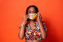 Stylish Black Woman Putting On Face Mask