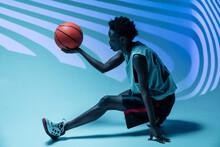 Studio Shot Of Basketball Player In The Studio